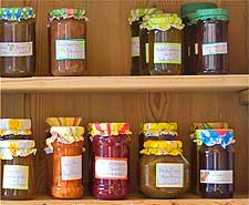 Further picture of homemade jam on a pine shelf